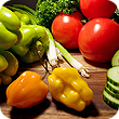 Vegetables including yellow, orange and green peppers, tomatoes, broccoli and cucumbers.